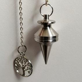 Pendule artisanal métal radiesthésie inox création unique