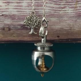 Pendule radiesthésie métal artisanal inox laiton ésotérique fait main arbre de vie topaze jaune création unique