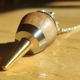 pendule radiesthésie métal bois inox artisanal fait main bouddha