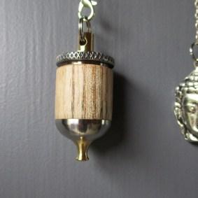 Création et fabrication 100% française de pendules de radiesthésie - Modèle pendule de radiesthésie inox, laiton et bois de Frêne Bouddha
